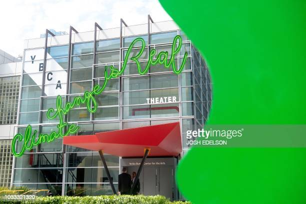 A neon sign reading 'Climate change is real' is seen at the Yerba Buena Center for the Arts during the Global Climate Action Summit in San Francisco...