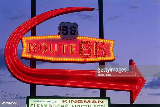 Neon sign 'Route 66' and arrow in Arizona in the dusk, USA