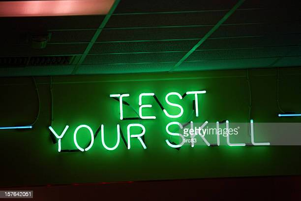 Neon sign showing test your skill