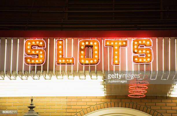 neon sign slots - coin operated stock photos and pictures