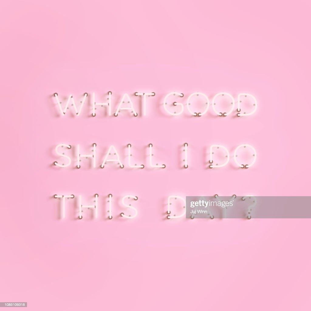 Neon sign with Benjamin Franklin quote: What good shall I do this day? : Foto de stock