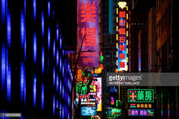 Neon signage for the Landmark Casino is seen in Macau on January 22 after the former Portuguese colony reported its first case of the new SARSlike...