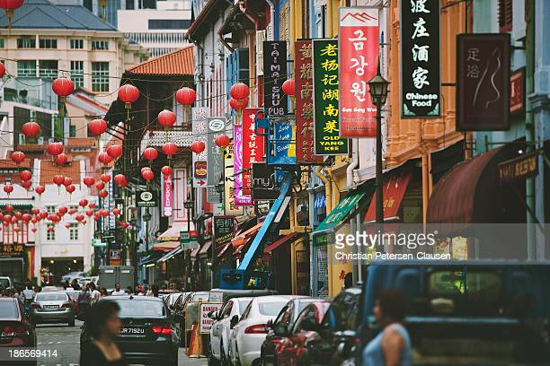 CONTENT] Neon signs advertising massage parlors restaurants hotels and small chinese shops line Temple Street in Chinatown Singapore