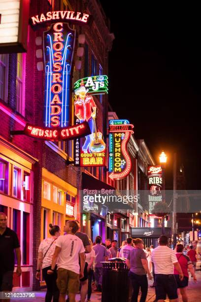 neon signs along the broadway in downtown nashville tennessee usa - nashville stock pictures, royalty-free photos & images