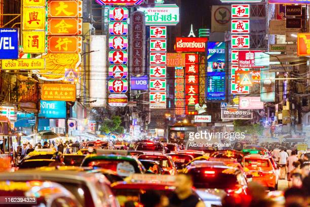 neon signs and traffic lights at night in chinatown, bangkok, thailand - bangkok stock pictures, royalty-free photos & images