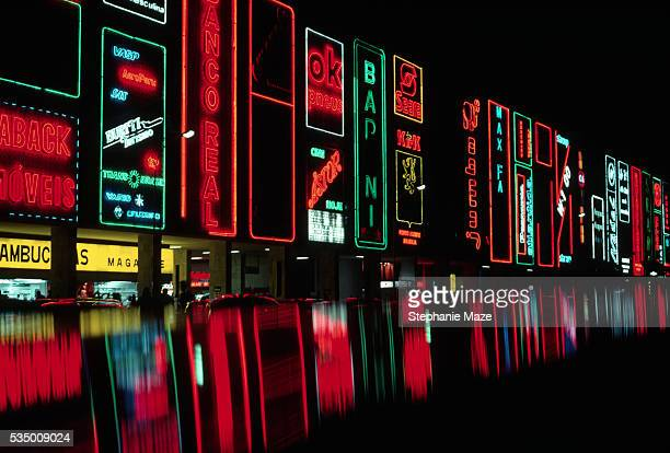 neon signs at night in brasilia - brasilia stock pictures, royalty-free photos & images