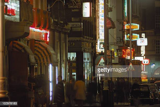 Neon signs illuminate the corner of Old Compton street Soho October 1970 Visible are signs for an adult revue and the Golden Lion pub on Dean Street