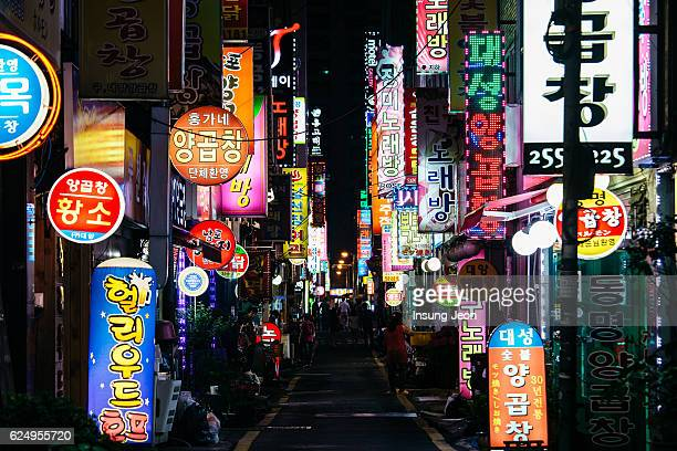 neon signs in busan nampo-dong street - korean culture stock pictures, royalty-free photos & images