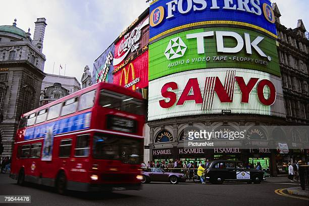 neon signs in piccadilly circus - piccadilly stock pictures, royalty-free photos & images