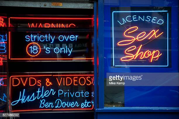 Neon signs in the windows of a sex shop adult entertainment store in London's red light district of Soho