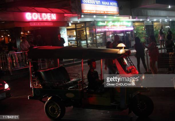 Neon signs of a gogo bar in the street of Soi Nana on Sukhumvit road a notorious hang out for foreign tourists looking for prostitutes on June 26...