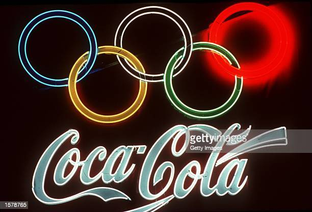 A neon signs of Olympic sponsor Coca Cola glows bright on a dark wall during the 1992 Olympic Games in Barcelona Spain Mandatory Credit Allsport...