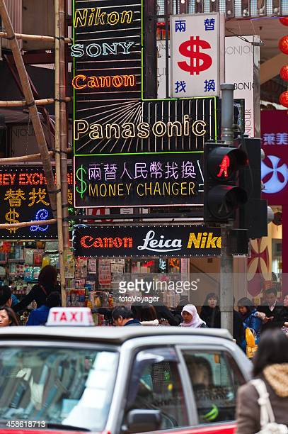 Neon signs on crowded city street Hong Kong