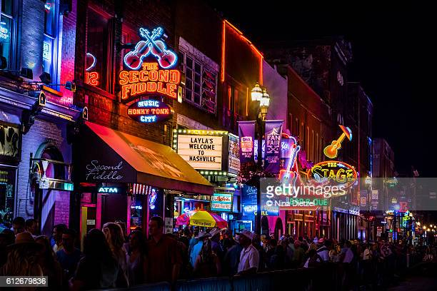 neon signs on lower broadway (nashville) at night - southern usa stock pictures, royalty-free photos & images