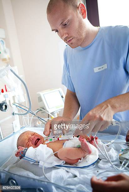 Neonatology service in a hospital in HauteSavoie France A newborn baby showing heart beat irregularities takes an ECG with a nurse