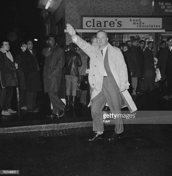 Neo-Nazi activist Colin Jordan performs a Nazi salute whilst leaving a cinema in Notting Hill, London, with his wife Françoise Dior , 16th February...