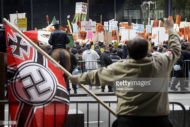 NeoNazi antagonizes people gathered at a sendoff rally supporting the Immigrant Workers Freedom Ride September 27 2003 in Chicago The Immigrant...