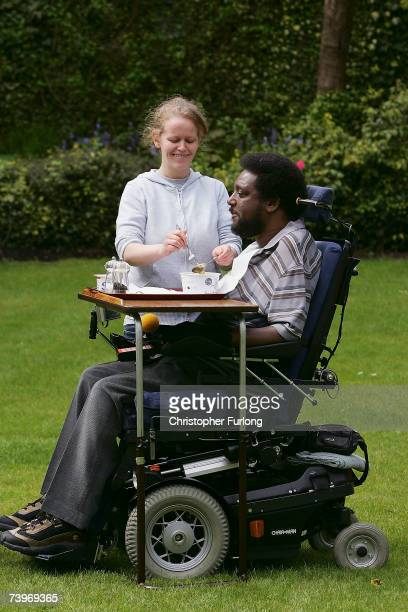 NeoNazi attack victim Noel Martin eats his lunch with help from one of his personal assistants in the garden of his home on April 25 in Birmingham...
