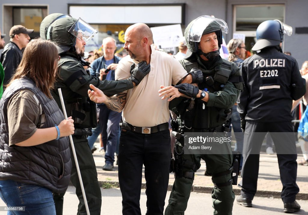 A Neo-Nazi demonstrator is arrested by police as he and others march at an extreme right-wing demonstration commemorating the 30th anniversary of the death of Nazi leader Rudolf Hess, Adolf Hitler's deputy, who received a life sentence at the Nuremberg trials and later committed suicide in Spandau prison in 1987, on August 19, 2017 in Berlin, Germany. Far-right political demonstrations are allowed in the country but with restrictions on Nazi slogans and symbols.