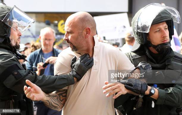 NeoNazi demonstrator is arrested by police as he and others march at an extreme rightwing demonstration commemorating the 30th anniversary of the...