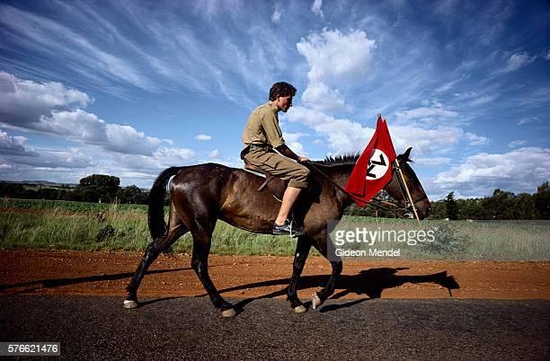 neo-nazi on horseback at great trek reenactment - nazi flag stock pictures, royalty-free photos & images