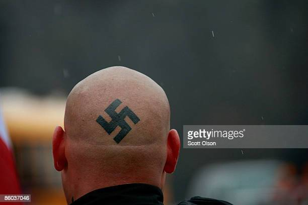 NeoNazi protestors organized by the National Socialist Movement demonstrate near where the grand opening ceremonies were held for the Illinois...