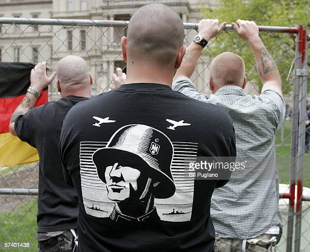 NeoNazi supporters listen to a speech during a NeoNazi rally at the steps of the Michigan State Capitol Building April 22 2006 in Lansing Michigan...