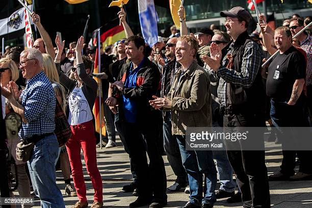 """Neo-Nazis and other right-wing activists gather in front of Hauptbahnhof railway station under the banner """"We for Berlin - We for Germany"""" to protest..."""
