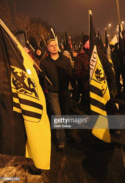NeoNazis and their sympathizers march to commemorate the World War II firebombing of Dresden by Allied planes on February 13 2012 in Dresden Germany...