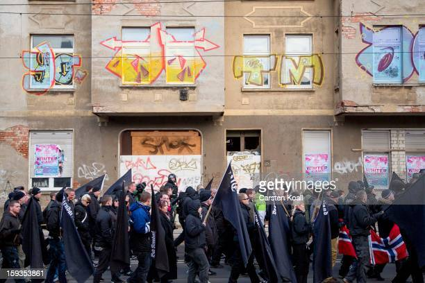 NeoNazis carry flags as they march during the commemoration of the 1945 Allied bombing of Magdeburg on January 12 2013 in Magdeburg Germany The...