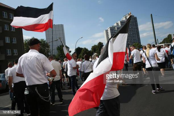 NeoNazis gather to march with flags in the colors of the former German Empire to commemorate the anniversary of the death of Rudolf Hess in...