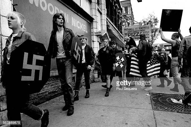 NeoNazis march across the street from Harry S Truman College during a counter protest at an antiracist graffiti rally Chicago Illinois 1976 Several...