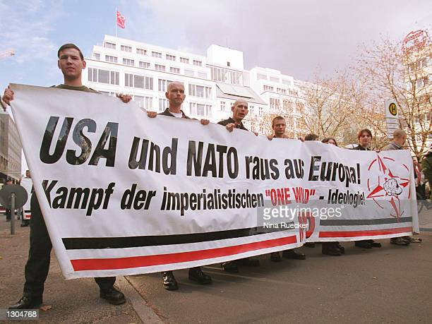 Neo-Nazis march November 4, 2000 in Berlin, Germany to protest the possible government ban on the far-right National Democratic Party that is...