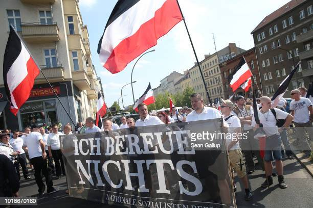 NeoNazis some holding a banner that reads I regret nothing gather to march with flags in the colors of the former German Empire to commemorate the...
