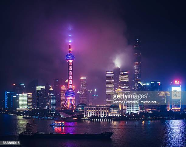 Neon-lit Pudong skyline at night in Shanghai, China