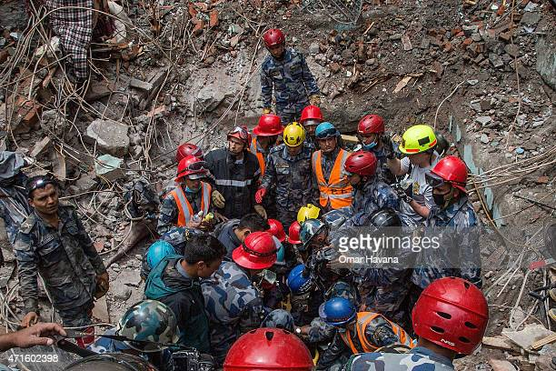 Nepal army forces in collaboration with members of an American Search and Rescue team rescue 15 year old Pemba Lama from a collapsed hotel five days...