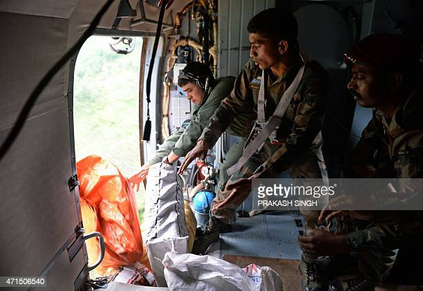 Nepal Army personnel drop relief materials at Larpak village in Gorkha northcentral Nepal on April 29 following a devastating earthquake on April 25...