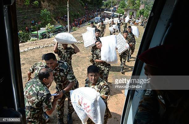 Nepal Army personnel load relief materials to be dropped at Larpak village in Kathmandu on April 29 following a devastating earthquake on April 25...