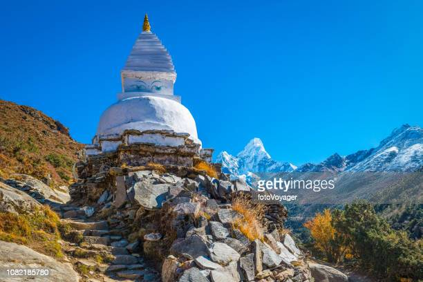 nepal buddhist stupa and mani stones overlooked by ama dablam himalayas - stupa stock pictures, royalty-free photos & images