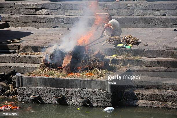 Nepal cremation ceremony at Pashupatinath by the Bagmati River Kathmandu October 2009