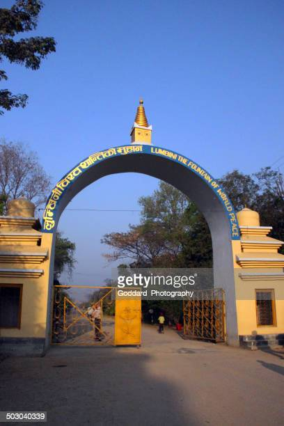 nepal: entrance to buddha's birthplace in lumbini - lumbini nepal stock pictures, royalty-free photos & images