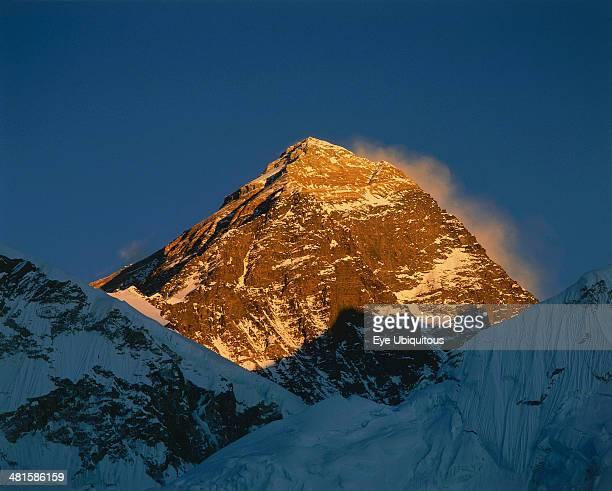 Nepal Everest National Park Mount Everest peak bathed in golden evening sunlight