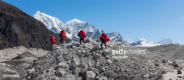 Nepal, Himalaya, Khumbu, Everest region, Porters on Ngozumpa glacier