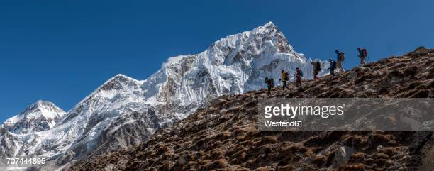 Nepal, Himalaya, Khumbu, Everest region, Trekkers and Nuptse
