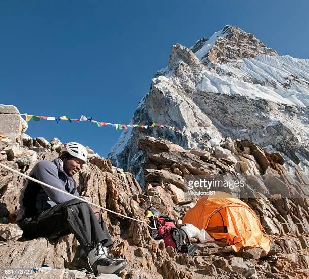 Nepal, Himalaya, Solo Khumbu, Everest region Ama Dablam, mountaineer resting at tent