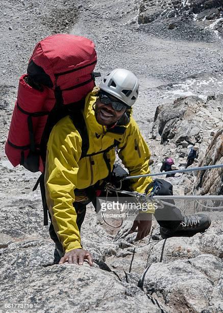 Nepal, Himalaya, Solo Khumbu, Everest region Ama Dablam, mountaineer climbing up rocks