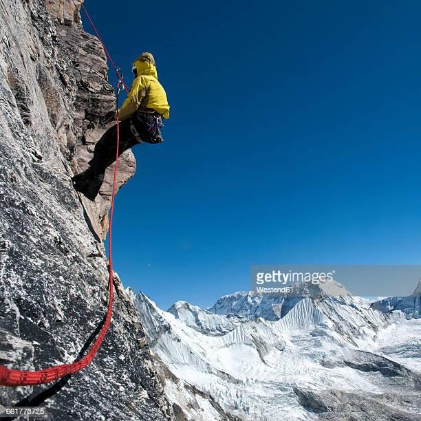 Nepal, Himalaya, Solo Khumbu, Everest region Ama Dablam, mountaineer with rope at rock face