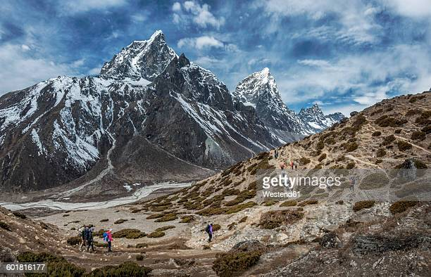 Nepal, Himalayas, Khumbu, Everest Region, Taboche, Mountaineers crossing mountains