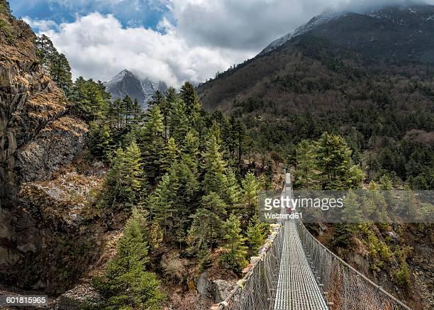 Nepal, Himalayas, Khumbu, Everest Region, Tengboche, person walking on suspension bridge