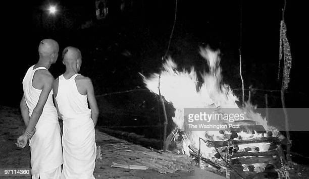 KATMANDU Nepal June 4 Two Hindu priests gaze at the flaming funeral pyre of former King Dipendra who was formally cremated tonight Dipendra who...